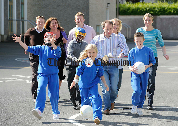 John Galvin, MD The Clare Champion, sponsor, tries his hand at hurling with Holy Family school pupils, Paddy Honan, Nzube Okoie, Elina Kovale and Aoife Flouch, Elina Kovale, Nzube Okoie and Paddy Honan at the launch of the Cumann na mBunscoil programme of events for this year. Bringing up the rear are: members of Cumann na mBunscoil an Clar; David Mc Cormack, treasurer, Sarah Barnes, Principal, Sean O Neill, chairman, Barbara Guilfoyle, secretary and Majella Lillis, PRO. Photograph by John Kelly.