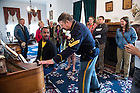 June 10, 2015; UNDERC West students, José Carlos Wharton Soto, 21, from Inter American University of Puerto Rico plays the piano for the tour guide in the Custer House at Fort Abraham Lincoln State Park in North Dekota.  (Photo by Barbara Johnston/University of Notre Dame)