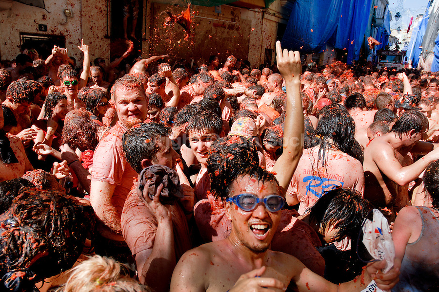 Thousands of people throw tomatoes during La Tomatina festival in Bunol, Spain, 31 August 2006. La Tomatina is a tomato fight held annually in the town of Bunol, close to Valencia. Approximately 40,000 people from all over the world arrive to fight in the battle in which about 50 tons of over-ripe tomatoes are thrown in the street. During the one hour battle everybody fights everybody by throwing squashed tomatoes. The origin of this event is unknown but the Tomatina fights have been recorded since 1945.