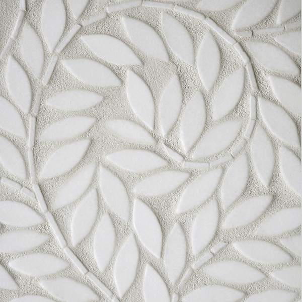 Jacqueline Vine, a natural stone waterjet mosaic shown in tumbled Thassos, is part of the Silk Road® collection by New Ravenna.