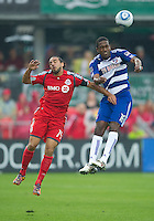 24 July 2010:   FC Dallas forward/midfielder Atiba Harris #16 and Toronto FC forward Dwayne De Rosario #14 in action during a game between FC Dallas and Toronto FC at BMO Field in Toronto..The final score was a 1-1 draw...