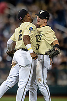 Vanderbilt Commodores second baseman Harrison Ray (20) celebrated with teammate Ethan Paul (10) following the end of the NCAA College World Series against the Louisville Cardinals on June 21, 2019 at TD Ameritrade Park in Omaha, Nebraska. Vanderbilt defeated Louisville 3-2 to head to the CWS Finals. (Andrew Woolley/Four Seam Images)