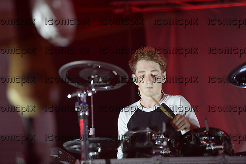 CLEAN BANDIT - drummer Luke Patterson - performing live at the Somerset House Summer Series concerts in London UK - 19 Jul 2014.  Photo credit: George Chin/IconicPix