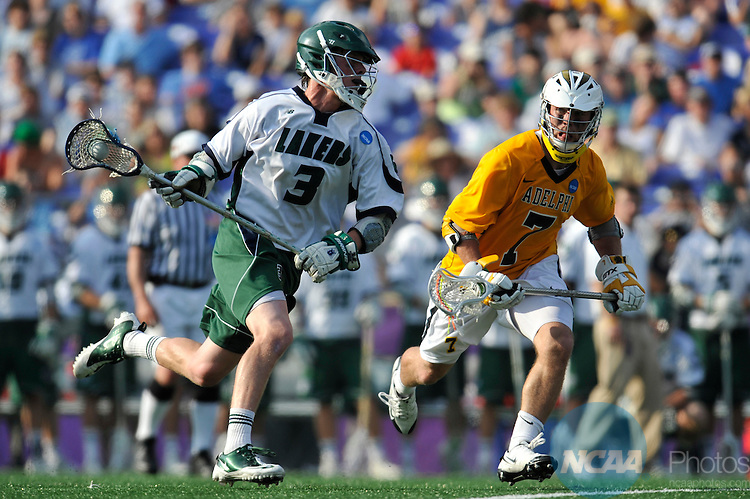 29 MAY 2011:  James Chayka (3) of Mercyhurst College moves the ball against Ken Fundus (7) of Adelphi University during the Division II Men's Lacrosse Championship held at M+T Bank Stadium in Baltimore, MD.  Mercyhurst defeated Adelphi 9-8 for the national title. Larry French/NCAA Photos