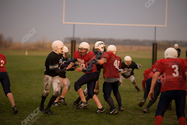 Richard Bring's son, Austin, 13 years old, with his team at a football game. Cooperstown, North Dakota, October 8, 2007.