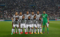 Calcio, quarti di finale di andata di Champions League: Juventus vs Monaco. Torino, Juventus stadium, 14 aprile 2015.<br /> Juventus players, back row, from left, Stephan Lichsteiner, Roberto Pereyra, Giorgio Chiellini, Alvaro Morata, Leonardo Bonucci and Gianluigi Buffon, and, front row, from left, Patrice Evra, Claudio Marchisio, Arturo Vidal, Andrea Pirlo and Carlos Tevez pose prior to the start of the Champions League quarterfinals first leg football match between Juventus and Monaco at Juventus stadium, 14 April 2015.<br /> UPDATE IMAGES PRESS/Isabella Bonotto