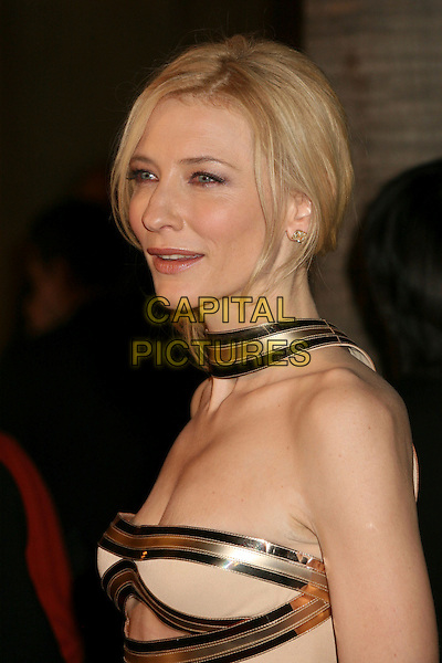"CATE BLANCHETT.Hollywood, California. Atmosphere. Los Angeles Premiere of ""The Good German"" at the Egyptian Theatre, Hollywood, California, USA..December 4th, 2006.headshot portrait gold beige strap stretch marks strapless.CAP/ADM/BP.©Byron Purvis/AdMedia/Capital Pictures"
