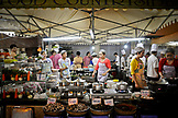VIETNAM, Ho Chi Minh Food Market, during evening, group of people cooking outdoors