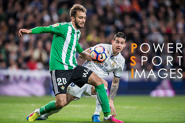 German Pezzella (l) of Real Betis fights for the ball with James Rodriguez of Real Madrid during their La Liga match between Real Madrid and Real Betis at the Santiago Bernabeu Stadium on 12 March 2017 in Madrid, Spain. Photo by Diego Gonzalez Souto / Power Sport Images
