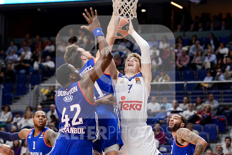 Real Madrid's Luka Doncic and Anadolu Efes's Bryant Dunston and Thomas Heurtel during Turkish Airlines Euroleague match between Real Madrid and Anadolu Efes at Wizink Center in Madrid, April 07, 2017. Spain.<br /> (ALTERPHOTOS/BorjaB.Hojas)