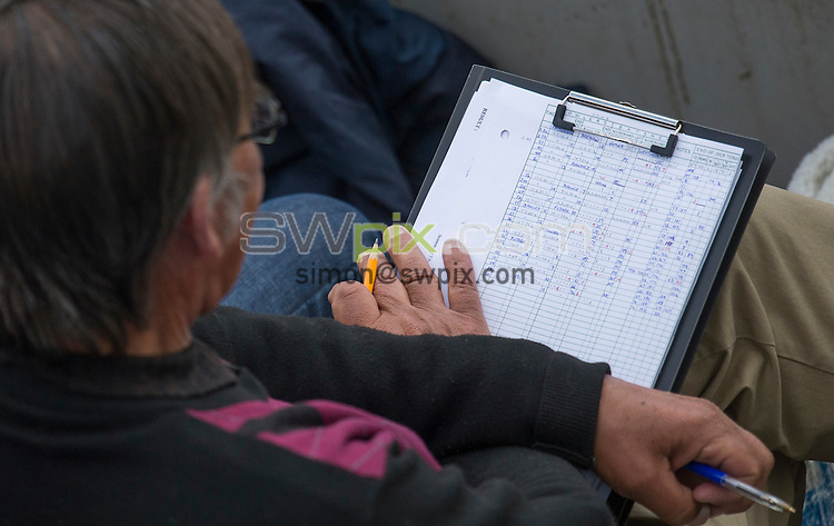 Picture by Allan McKenzie/SWpix.com - 26/04/2015 - Cricket - LV County Championship Div One - Yorkshire County Cricket Club v Warwickshire County Cricket Club - Headingley Cricket Ground, Leeds, England - Fans and supporters filling out scorecards.