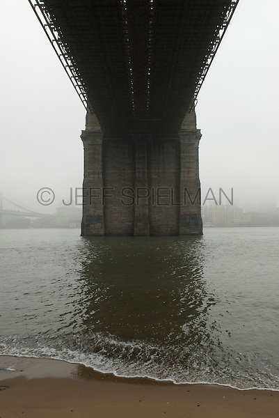 Upward View of Brooklyn Bridge and the East River on a Foggy Morning, Photographed from The Lower Manhattan East River Promenade, New York City, New York State, USA