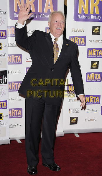 Keith Chegwin.Reality TV Awards at the Porchester Hall, London, England..August 30th 2012.full length shirt white black suit brown tie hand arm waving .CAP/CAN.©Can Nguyen/Capital Pictures.