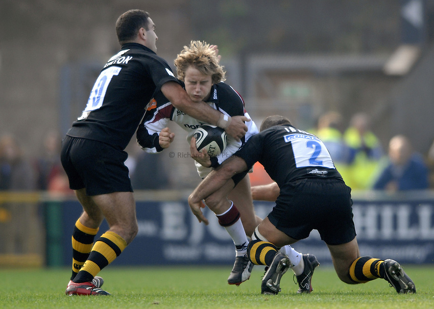 Photo: Richard Lane..London Wasps v Newcastle Falcons. Guinness Premiership. 15/10/2006. .Falcons' Mathew Tait is tackled by Jeremy Staunton and Raphael Ibanez.