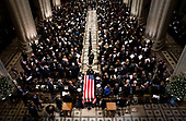The Honor Guard carries the casket of former president George Herbert Walker Bush down the center isle following a memorial ceremony at the National Cathedral in Washington, Wednesday,  Dec.. 5, 2018.<br /> Credit: Doug Mills / Pool via CNP