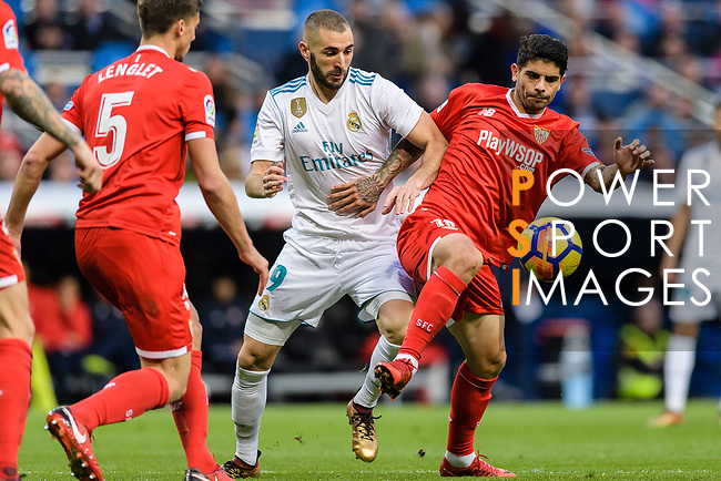 Karim Benzema of Real Madrid (L) fights for the ball with Ever Banega of Sevilla FC (R) during La Liga 2017-18 match between Real Madrid and Sevilla FC at Santiago Bernabeu Stadium on 09 December 2017 in Madrid, Spain. Photo by Diego Souto / Power Sport Images
