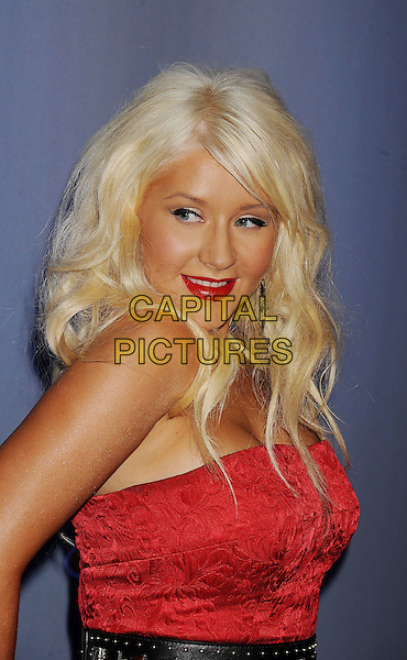 "CHRISTINA AGUILERA.NBC's Press Conference for ""The Voice"" at L.A. Center Studios in Los Angeles, California, USA..March 15th, 2011.half length red strapless dress black belt lipstick .CAP/ROT/TM.© TM/Roth/Capital Pictures"