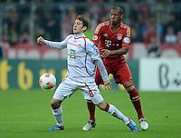 FUSSBALL  DFB POKAL       SAISON 2012/2013 FC Bayern Muenchen - 1 FC Kaiserslautern  31.10.2012 Konstantinos Fortounis (li, 1. FC Kaiserslautern) gegen Jerome Boateng (FC Bayern Muenchen)
