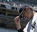 Masahiro Tanaka (Yankees),<br /> AUGUST 9, 2015 - MLB :<br /> Masahiro Tanaka of the New York Yankees reacts as he walks back to the dugout after the top of the fifth inning during the Major League Baseball game against the Toronto Blue Jays at Yankee Stadium in the Bronx, New York, United States. (Photo by AFLO)