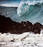 USA, Hawaii, Oahu, a surfer dropping in on a large wave at Waimea Bay