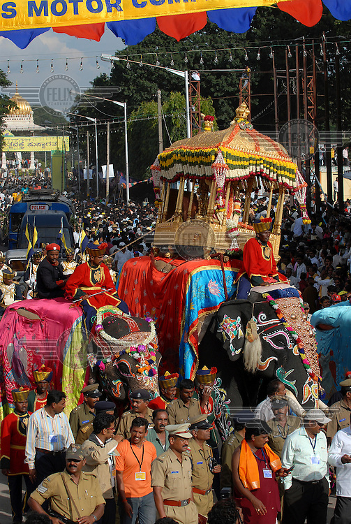 """The 840 kg solid gold """"Howdah"""" being transported on back of an elephant during the annual Dussera (Dasara) Festival."""