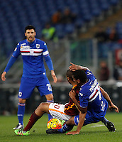 Calcio, Serie A: Roma vs Sampdoria. Roma, stadio Olimpico, 7 febbraio 2016.<br /> Roma&rsquo;s Seydou Keita, left, is fouled by Sampdoria&rsquo;s Lucas Fernando during the Italian Serie A football match between Roma and Sampdoria at Rome's Olympic stadium, 7 January 2016.<br /> UPDATE IMAGES PRESS/Riccardo De Luca