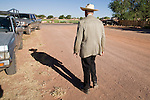 """June 16, 2008 -- COLORADO CITY, AZ: JOSEPH JESSOP, 86 years old, walks down a street in Colorado City, AZ. Jessop, a polygamist and member of the FLDS, was arrested during the Short Creek Raid in 1953 and had his wives and children taken from him for two years. Colorado City and neighboring town of Hildale, UT, are home to the Fundamentalist Church of Jesus Christ of Latter Day Saints (FLDS) which split from the mainstream Church of Jesus Christ of Latter Day Saints (Mormons) after the Mormons banned plural marriage (polygamy) in 1890 so that Utah could gain statehood into the United States. The FLDS Prophet (leader), Warren Jeffs, has been convicted in Utah of """"rape as an accomplice"""" for arranging the marriage of teenage girl to her cousin and is currently on trial for similar, those less serious, charges in Arizona. After Texas child protection authorities raided the Yearning for Zion Ranch, (the FLDS compound in Eldorado, TX) many members of the FLDS community in Colorado City/Hildale fear either Arizona or Utah authorities could raid their homes in the same way. Older members of the community still remember the Short Creek Raid of 1953 when Arizona authorities using National Guard troops, raided the community, arresting the men and placing women and children in """"protective"""" custody. After two years in foster care, the women and children returned to their homes. After the raid, the FLDS Church eliminated any connection to the """"Short Creek raid"""" by renaming their town Colorado City in Arizona and Hildale in Utah.  Photo by Jack Kurtz / ZUMA Press"""