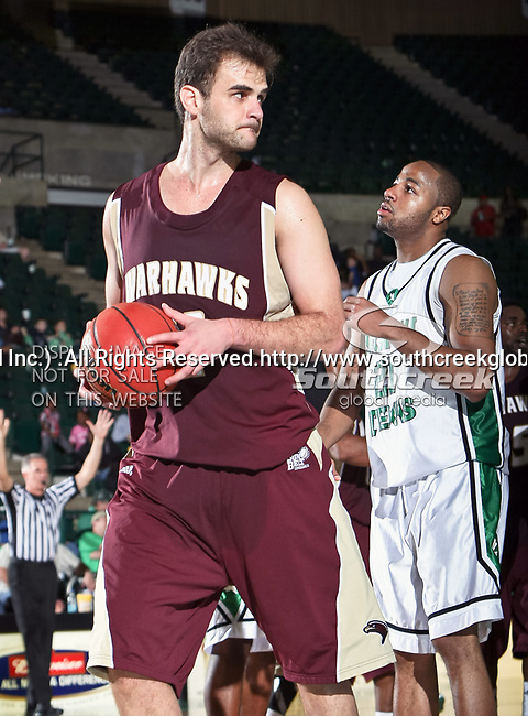 University of Louisiana at Monroe Warhawks center Fabio Ribeiro (41) and North Texas Mean Green guard Shannon Shorter (21) in action during the NCAA  basketball game between the University of Louisiana at Monroe Warhawks and the University of North Texas Mean Green at the North Texas Coliseum,the Super Pit, in Denton, Texas. ULM defeated UNT 82 to 75...