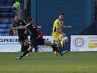 Kenny McLean crosses past Paul Quinn in the Ross County v St Mirren Scottish Professional Football League match played at the Global Energy Stadium, Dingwall on 17.1.15.