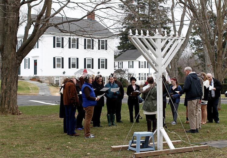 Middlebury, CT- 16 December 2014-121614CM08--- country life only please---  Members of the community along with students and staff from Westover School, sing Hanukkah songs during the annual Menorah Lighting on the Middlebury Green on Tuesday. The ceremony was arranged by the Middlebury Congregational Church, which owns the Green, and Westover School, whose maintenance staff sets up the menorah, as a gift to their Jewish neighbors.   Christopher Massa Republican-American