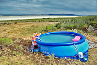 Small plastic swimming pool on the edge of the Alvord Desert. Oregon