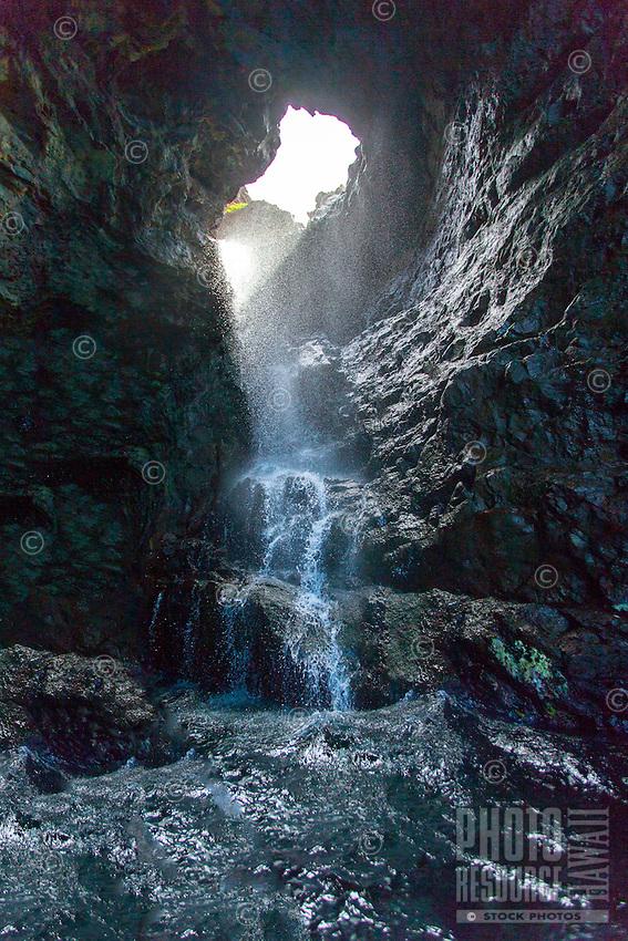 Waterfall inside a sea cave on the Na Pali Coast, Kaua'i