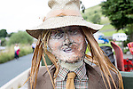 Scarecrow Festival at Kettlewell in Yorkshire 2013<br /> <br /> Farmer's face<br /> <br /> <br /> Scarecrows are made by local community and places in and around their front gardens.  Competition is fierce but it's all to raise money  for the local church  and other local projects to benefit the whole community.<br /> <br /> <br /> <br /> Picture by Gavin Rodgers/ Pixel 8000 <br /> <br /> 07917221968