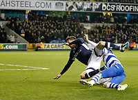 Lee Gregory of Millwall is felled by Grant Hall of Queens Park Rangers  during the Sky Bet Championship match between Millwall and Queens Park Rangers at The Den, London, England on 29 December 2017. Photo by Carlton Myrie / PRiME Media Images.