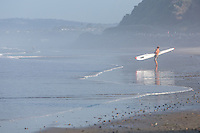 Male Holding a Surf Ski on the Beach in San Clemente