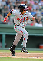 Infielder Matt Weaver (4) of the Rome Braves, Class A affiliate of the Atlanta Braves, in a game against the Greenville Drive on July 18, 2011, at Fluor Field at the West End in Greenville, South Carolina. (Tom Priddy/Four Seam Images)