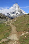 Hiking trail and the Matterhorn above Zermatt, Switzerland. .  John leads hiking and photo tours throughout Colorado.