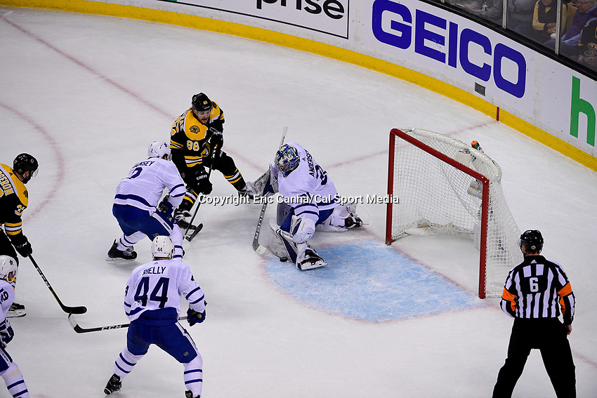 April 21, 2018: Toronto Maple Leafs goaltender Frederik Andersen (31) makes a save on a shot by Boston Bruins right wing David Pastrnak (88) during game five of the first round of the National Hockey League's Eastern Conference Stanley Cup playoffs between the Toronto Maple Leafs and the Boston Bruins held at TD Garden, in Boston, Mass. Toronto defeats Boston 4-3, Boston leads Toronto 3 games to 2 in the best of 7 series.