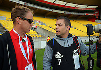 Event media liaison Robbie Titchener talks to photographer Marin Seras Lima on day one of the 2016 HSBC Wellington Sevens at Westpac Stadium, Wellington, New Zealand on Saturday, 30 January 2016. Photo: Dave Lintott / lintottphoto.co.nz