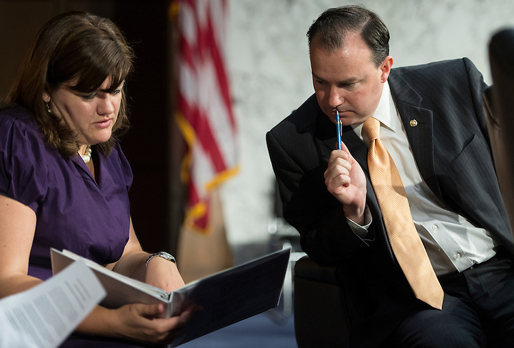 "UNITED STATES - JUNE 14: Sen. Mike Lee, R-Utah, confers with staff before the start of the Senate Foreign Relations Committee hearing on ""The Law of the Sea Convention: Perspectives From the U.S. Military"" on Thursday, June 14, 2012. (Photo By Bill Clark/CQ Roll Call)"