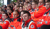 MSV Arena, Duisburg, North Rhine-Westphalia, Germany - Members of emergency services attend the event. A commemorative service is held on the 1st anniversary of the Loveparade tragedy in which 21 young people lost their lives and hundreds were injured as they tried to get to the event to celebrate life, love and music; to date, politicians, organisers and police still try to apportion blame, Photo Credit: Bettina Strenske