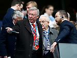 Former manager Sir Alex Ferguson enquiries about the seating during the Barclays Premier League match at The Etihad Stadium. Photo credit should read: Simon Bellis/Sportimage