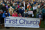 "Members of First United Methodist Church of Seattle hold a banner as they joined hundreds of other Seattle residents who marched from Westlake Center Park to the Seattle Center on January 13, 2013, calling for stricter regulations of firearms. Sponsored by a network of churches and other groups called ""Stand-up Washington,"" the demonstrators called for a state ban on semi-automatic weapons as well as stricter gun laws."