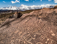 Rock art and Sierra Nevda Range, California. Location secret to protect site Ancient Native American.petroglyphs