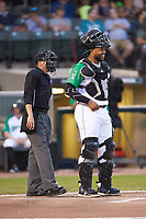Dayton Dragons catcher Hendrik Clementina (24) shares a laugh with home plate umpire Harrison Silverman prior to the game against the Bowling Green Hot Rods at Fifth Third Field on June 8, 2018 in Dayton, Ohio. The Hot Rods defeated the Dragons 11-4.  (Brian Westerholt/Four Seam Images)