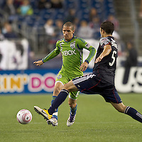 Seattle Sounders midfielder Osvaldo Alonso (6) passes the ball. In a Major League Soccer (MLS) match, the Seattle Sounders FC defeated the New England Revolution, 2-1, at Gillette Stadium on October 1, 2011.