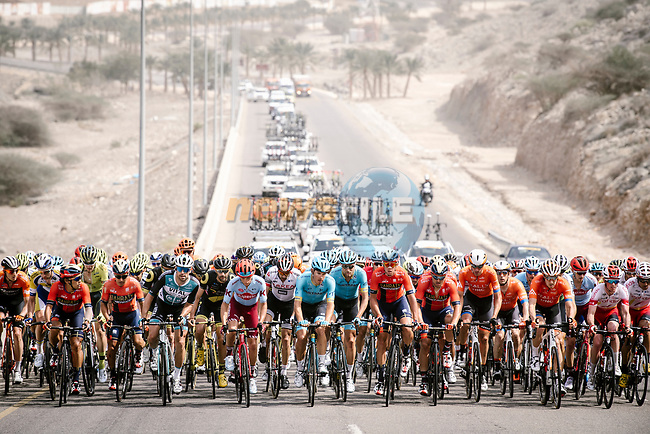 The peloton spread wide across the road during Stage 6 of the 10th Tour of Oman 2019, running 135.5km from Al Mouj Muscat to Matrah Corniche, Oman. 21st February 2019.<br /> Picture: ASO/P. Ballet | Cyclefile<br /> All photos usage must carry mandatory copyright credit (© Cyclefile | ASO/P. Ballet)