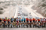 The peloton spread wide across the road during Stage 6 of the 10th Tour of Oman 2019, running 135.5km from Al Mouj Muscat to Matrah Corniche, Oman. 21st February 2019.<br /> Picture: ASO/P. Ballet | Cyclefile<br /> All photos usage must carry mandatory copyright credit (&copy; Cyclefile | ASO/P. Ballet)