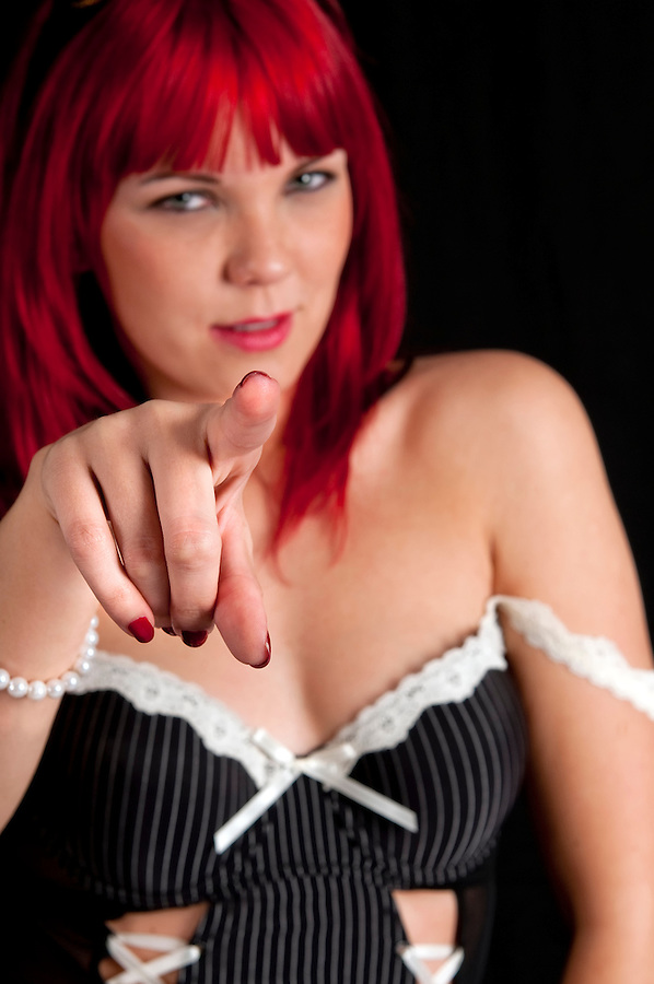 Sensual woman in lingerie pointing with finger.