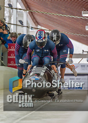 9 January 2016: United States of America pilot Nick Cunningham leads his 4-man team as they push off their first run of the day at the BMW IBSF World Cup Bobsled Championships at the Olympic Sports Track in Lake Placid, New York, USA. Cunningham's team came in 9th for the day, with a 2-run combined time of 1:50.72. Mandatory Credit: Ed Wolfstein Photo *** RAW (NEF) Image File Available ***